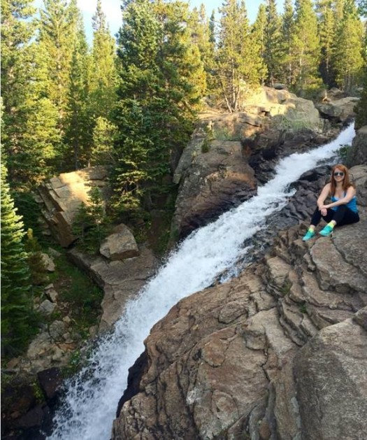 Pictured above is Caitlin this past summer. She is hiking to Alberta Falls in Estes Park, Colorado
